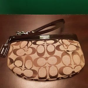 Authentic Coach brown monogram wristlet
